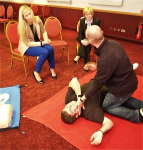 first aid training course showing the recovery position
