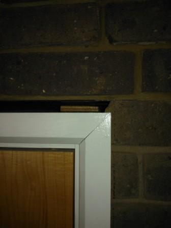 poorly fitted fire door